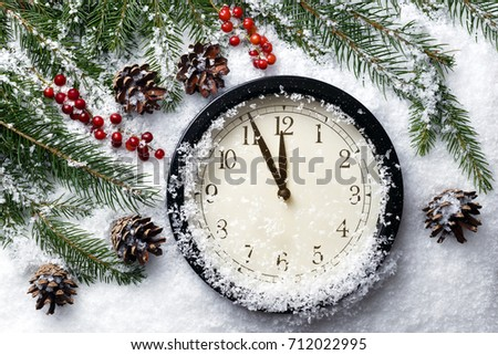 Christmas or New Year's clock. The last moments before midnight.