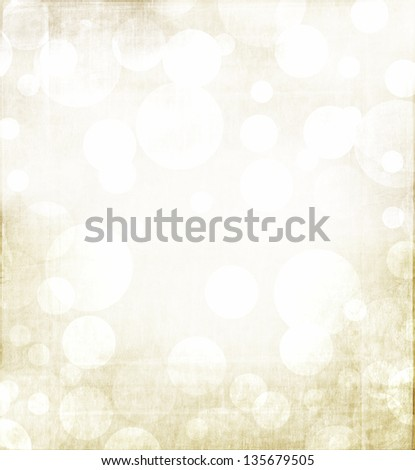 Christmas or winter abstract background with golden tones and a grunge metallic overlay. - stock photo