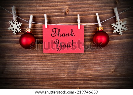 Christmas or Winter Background with a Red Label with the Words Thank You on a Line - stock photo