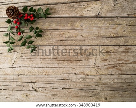 Christmas ornament and pine on wooden background - stock photo