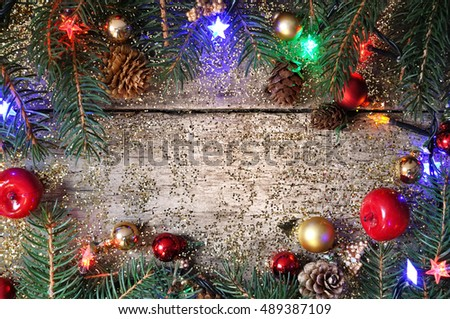 Christmas ornament bordering a wooden plank with empty space in th middle