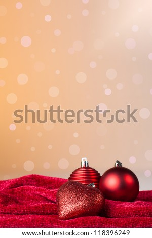 Christmas ornament: christmas balls and a red heart with a background of defocused lights - stock photo