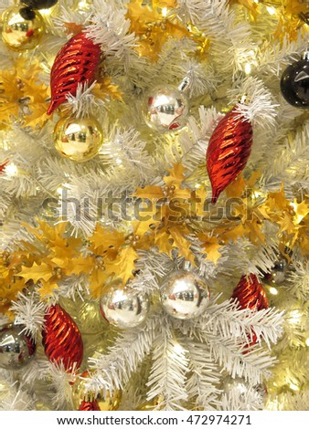 christmas ornament decorative objects on white christmas tree , background for holiday season