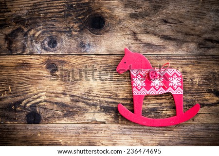 Christmas ornament depicting a horse trinket. - stock photo