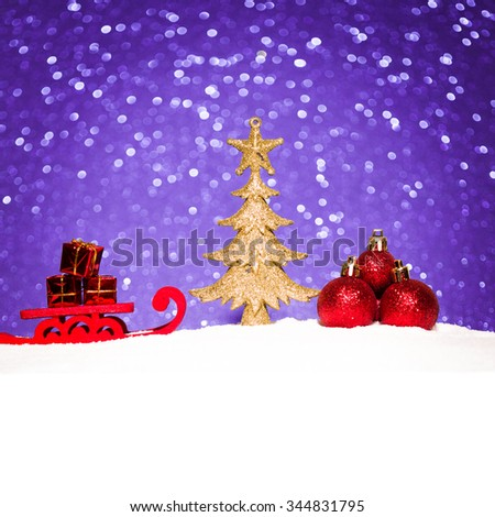 christmas ornament in snow on glitter background. studio shot