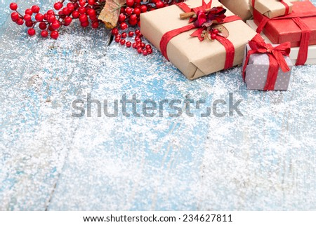 christmas ornament in snow on wood background. studio shot - stock photo