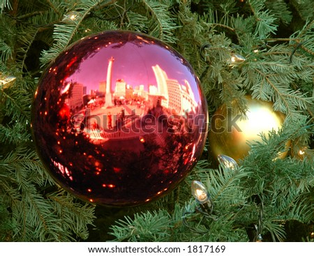 Christmas ornament nestled in tree on Union Square, San Francisco - stock photo