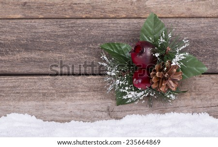 Christmas ornament on a wooden background with snow - stock photo