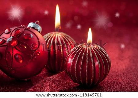 Christmas ornament with candles in red tone with glittering background - stock photo