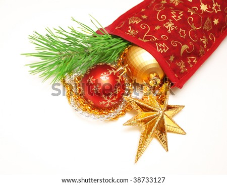 Christmas ornaments and branch of a pine