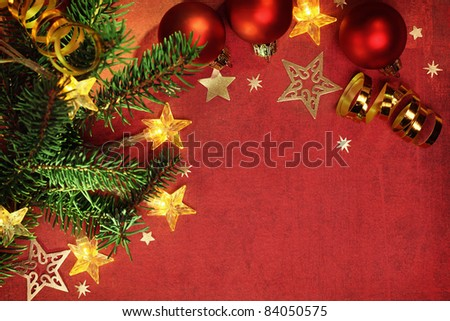 Christmas ornaments and electric lights on grunge background - stock photo