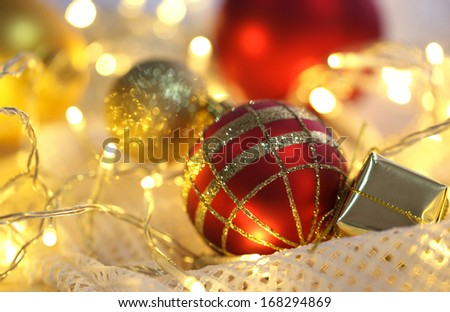 Christmas ornaments and garland on bright background close-up - stock photo