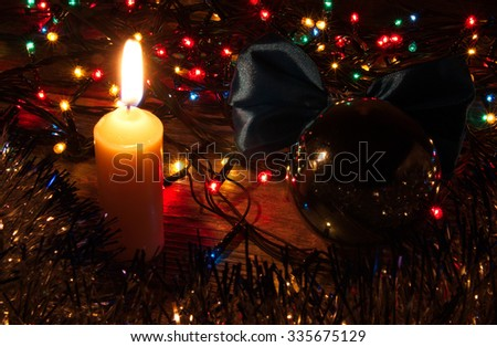 Christmas ornaments, garlands, glowing lights and festive mood - stock photo