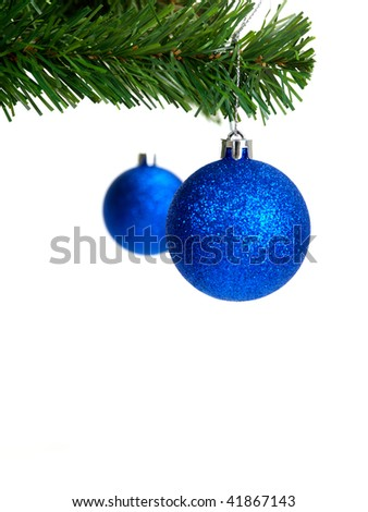 Christmas ornaments hanging from a christmas tree isolated against a white background