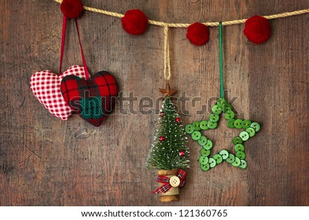 Christmas ornaments hanging on wood background