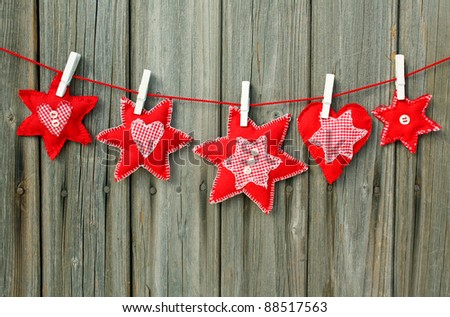 christmas ornaments hanging outdoor on line - stock photo