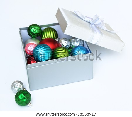 Christmas ornaments in gift box - stock photo