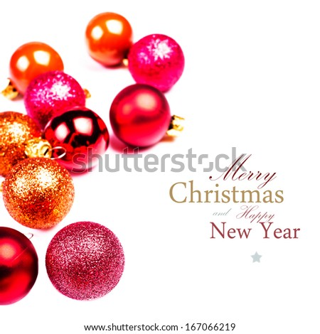 Christmas Ornaments isolated on white backhrouns. Festive glittering red balls close up with copy space for greeting text. - stock photo
