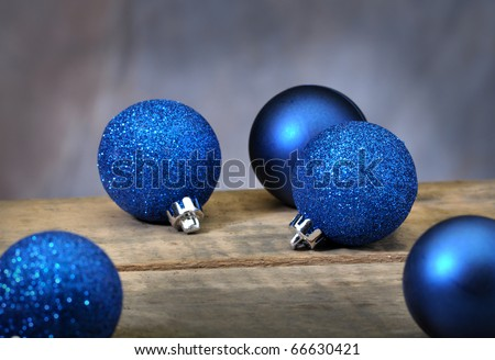 Christmas ornaments on a old vintage table with studio tan background