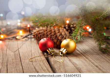 Christmas ornaments on a table in the snow with a nice festive background Xmas illuminations