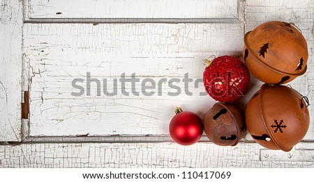 Christmas ornaments on antique cracked wood panel - stock photo