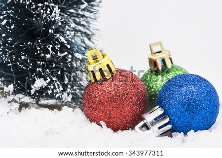 Christmas ornaments on snow. - stock photo