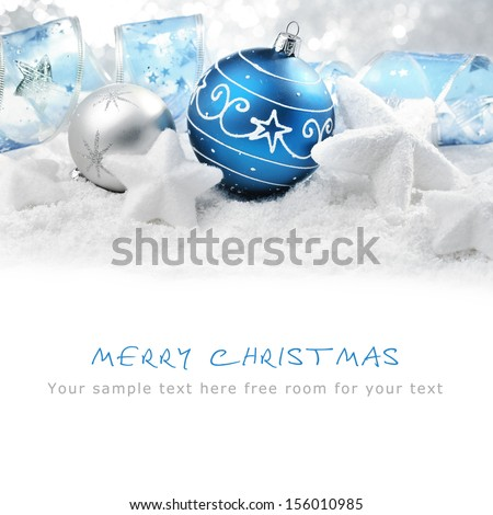 Christmas ornaments on snow,Copy space for your text. - stock photo