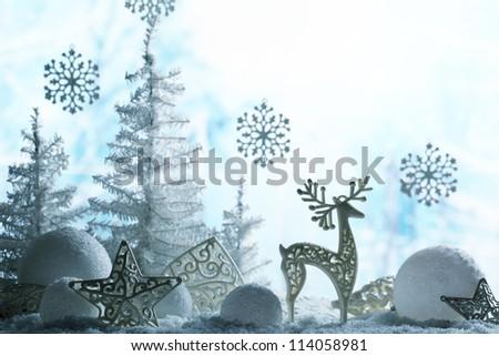 Christmas ornaments on snowflakes. - stock photo