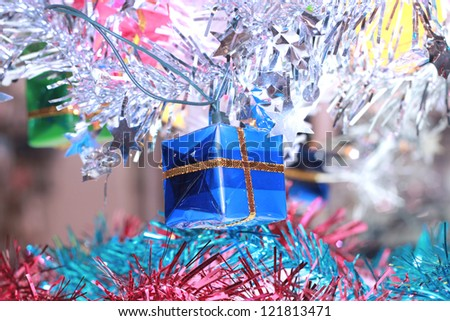 Christmas ornaments presented on a branch tree - stock photo