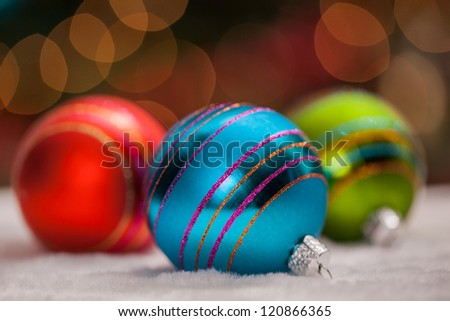 Christmas ornaments under defocused lights