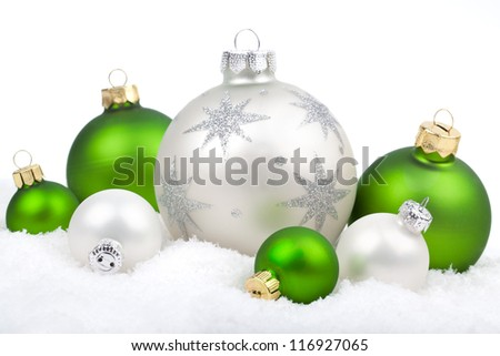 Christmas ornaments with snow - white and green , on a white background with copy space - stock photo