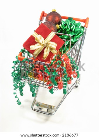 Christmas packages, ornaments and a curled ribbon in a miniature shopping cart.