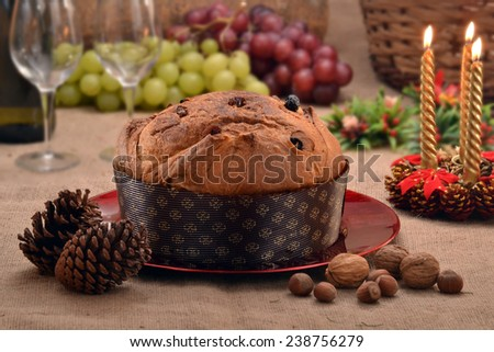 Christmas panettone and ingredients on rustic ambient. - stock photo