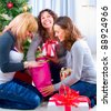 Christmas Party. Friends with Christmas Gifts - stock photo