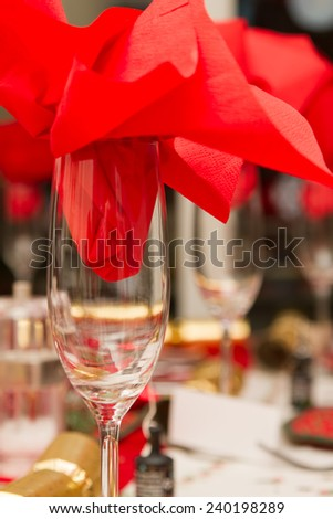 Christmas party table with red napkin in a glass - stock photo