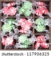 Christmas peppermint candy wrapped in a printers box - stock photo