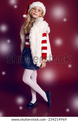 Christmas photo of little cute girl 9 years old wearing Santa  - stock photo