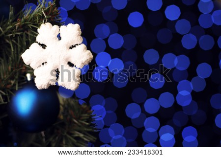 Christmas photo with Christmas tree, snowflakes and baubles on bright background with blue and blue lights - stock photo