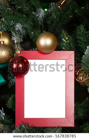 Christmas picture frame decorated with New Year's spheres - stock photo