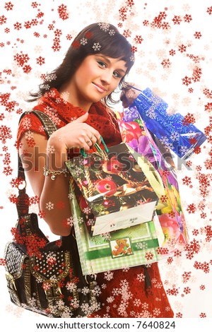 christmas picture of  girl with shopping bags and snowflakes
