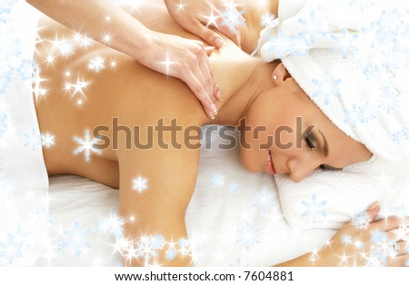 christmas picture of lovely lady relaxing in massage salon - stock photo