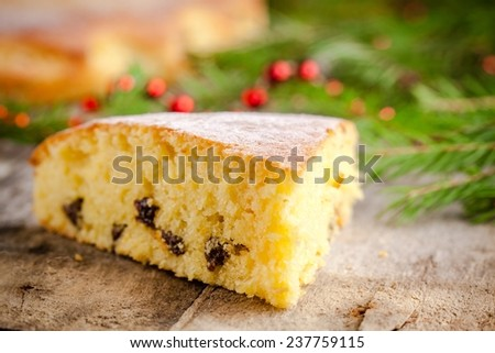 Christmas piece of biscuit cake on a rustic background - stock photo