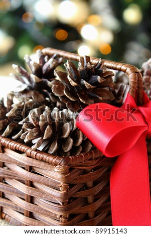 Christmas pine cones in a basket - stock photo