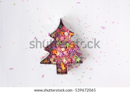 christmas pine tree shape with sugar sprinkles on a white background