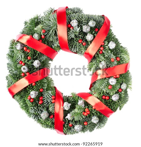 Christmas pine wreath and red berries isolated on white background - stock photo