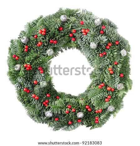 Christmas pine wreath with red berries and pine cones isolated on white background - stock photo