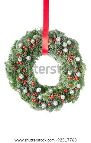 Christmas pine wreath with red ribbon isolated on white background - stock photo