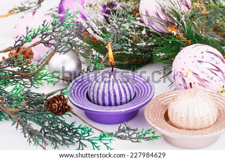 Christmas pink balls, candle and fir tree on gray background. - stock photo