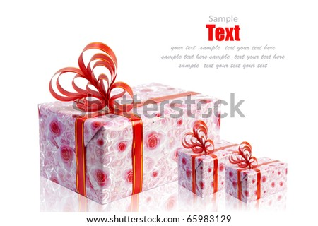 Christmas pink rose gift box tied with red ribbon bow on white background - stock photo
