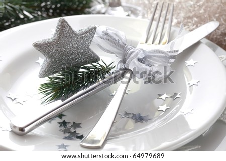 christmas place setting in silver with star - stock photo